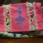 Dance messenger bag with dancer appliqué