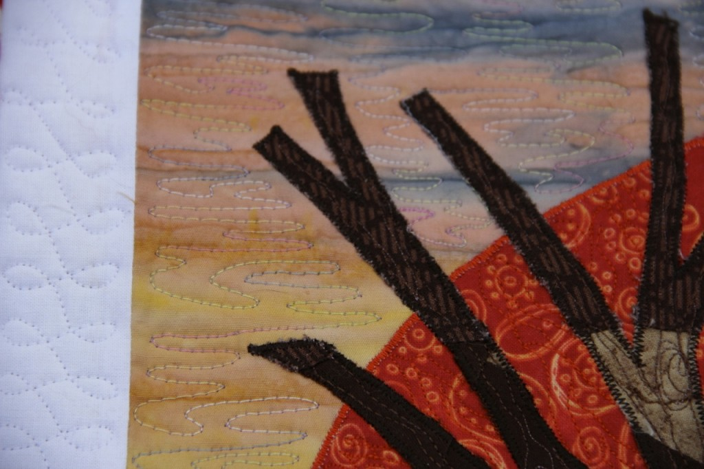 Tree in the Sunset mini quilt: variegated thread quilting
