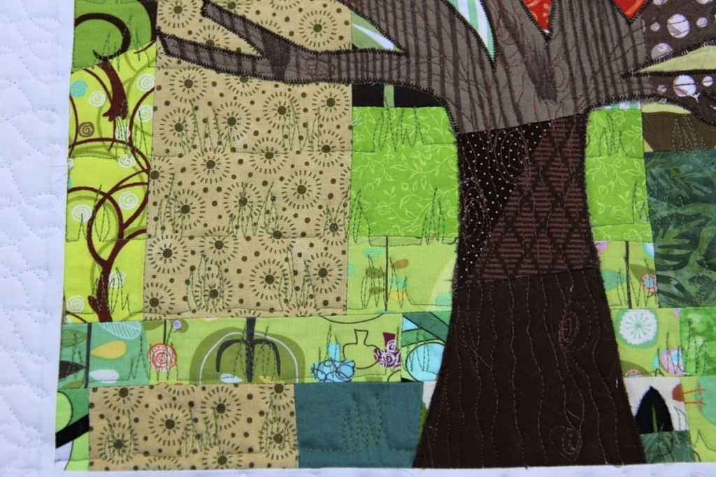 Tree in the Sunset mini quilt: Grass and tree bark quilting