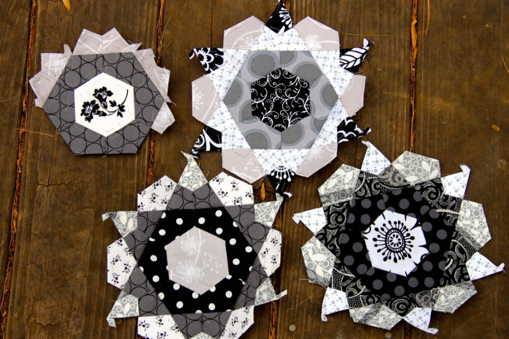 English paper pieced monochromatic rose stars gray