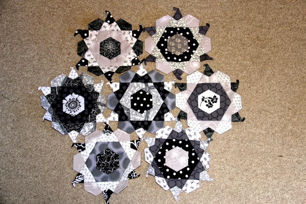 Monochromatic English paper pieced rose stars